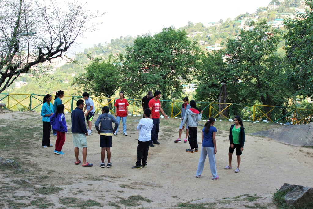 Children practising team building exercises before the trek