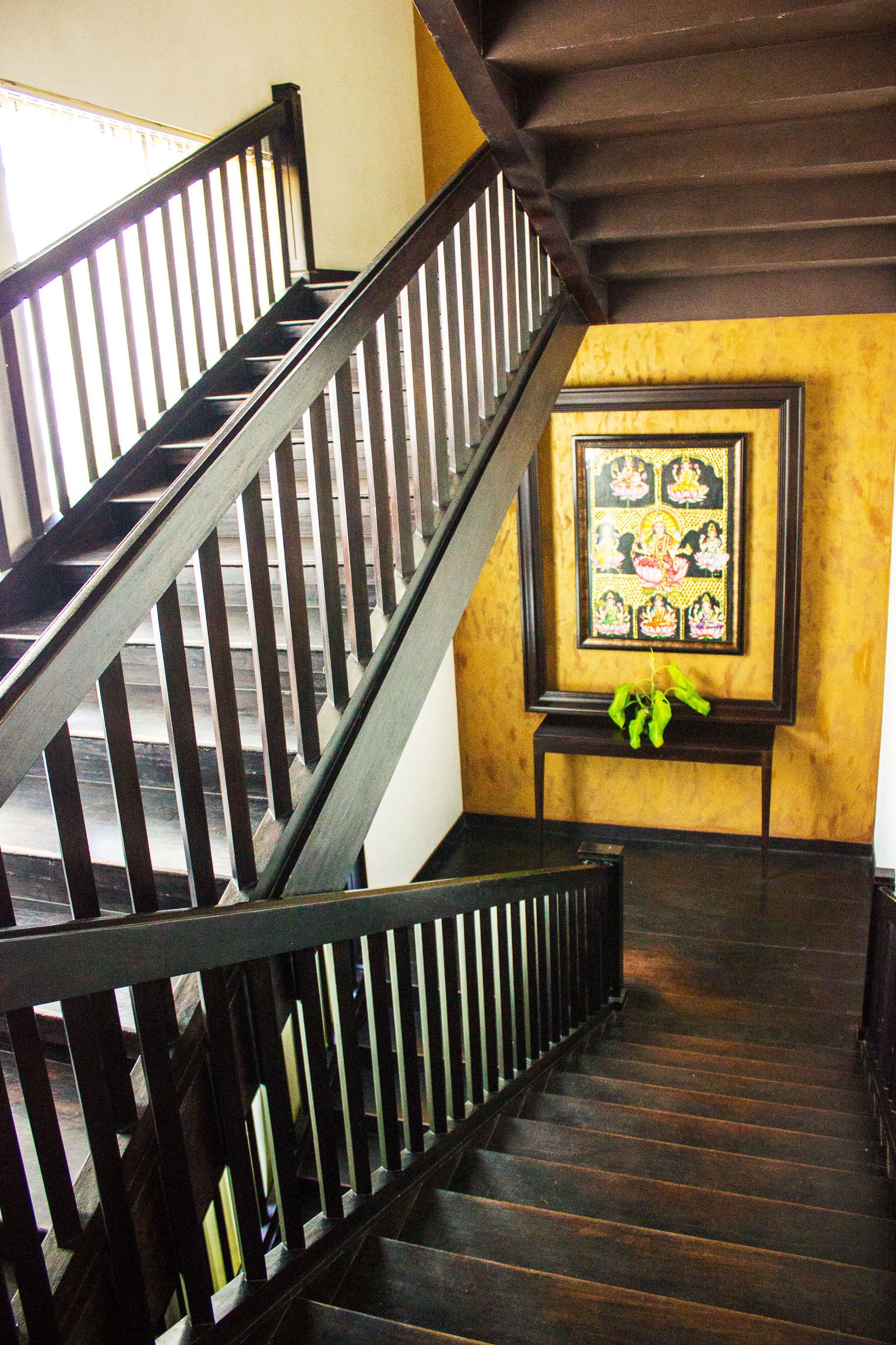 Teakwood stairways and corridors are dotted with traditional paintings