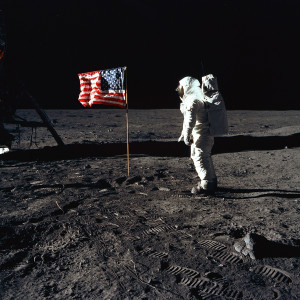 "Astronaut Buzz Aldrin, lunar module pilot of the first lunar landing mission, poses for a photograph beside the deployed United States flag during an Apollo 11 Extravehicular Activity (EVA) on the lunar surface. The Lunar Module (LM) is on the left, and the footprints of the astronauts are clearly visible in the soil of the Moon. Astronaut Neil A. Armstrong, commander, took this picture with a 70mm Hasselblad lunar surface camera. While astronauts Armstrong and Aldrin descended in the LM, the ""Eagle"", to explore the Sea of Tranquility region of the Moon, astronaut Michael Collins, command module pilot, remained with the Command and Service Modules (CSM) ""Columbia"" in lunar-orbit.; Image credit"